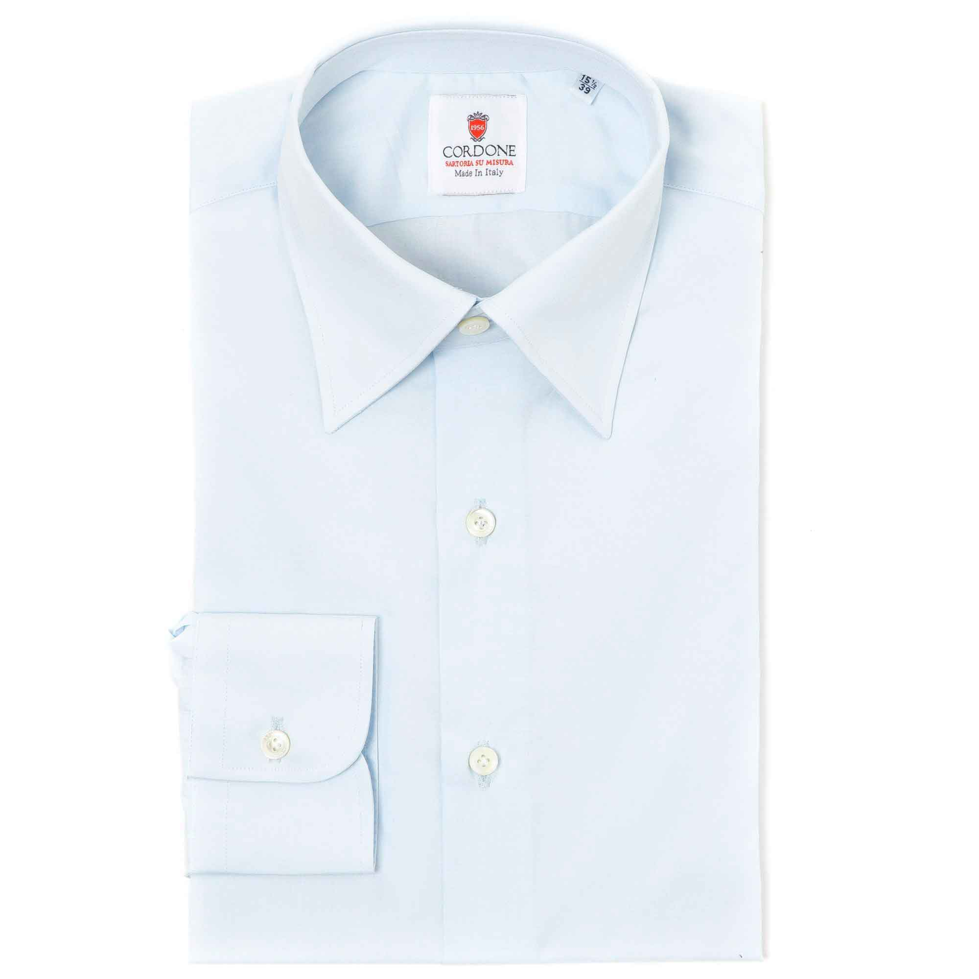 Camisa lisa azul botón oculto